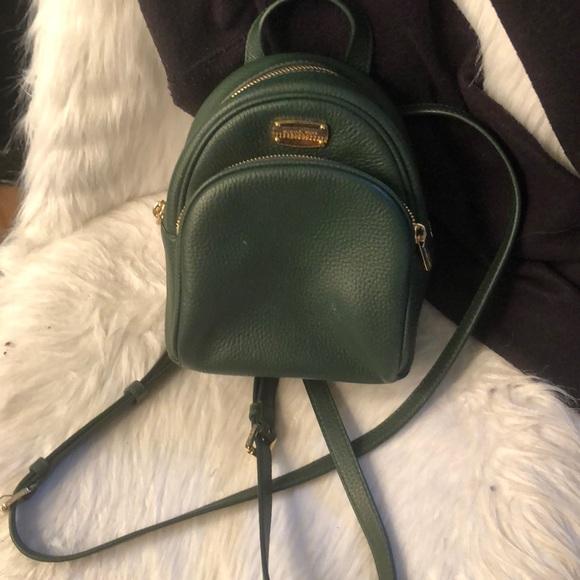 95e9aa7bce05 army green michael kors mini backpack. M 5afb1b33daa8f67e249dc5c2